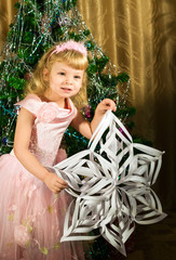 Little girl with Christmas snowflake