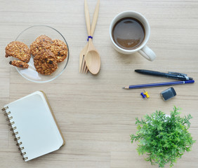Blank paper, coffee break and office tools on the wood table - T