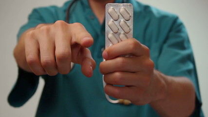 Doctor giving strict order patient, taking prescribed medication