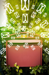 Mailbox with letter icons on glowing green background