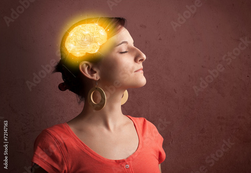 canvas print picture Young girl thinking with glowing brain illustration