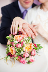 bridal bouquet of roses, buttercups and other flowers