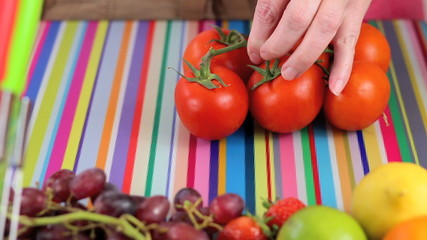 Preparing vine tomatoes in colorful kitchen