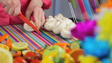 Preparing mushrooms in colorful kitchen