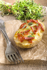 baked potato with cheese and chorizo