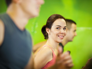 Beautiful young women exercising in a fitness center