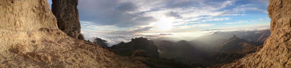 View through mountain cliffs of the sunrise