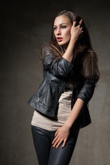 attractive woman in black leather jacket and pants