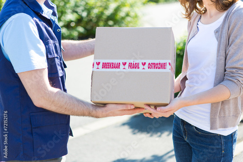 canvas print picture Details of parcel being handed over by a professional