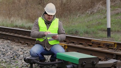 Railway employee with tablet PC