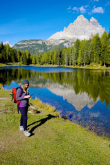 Woman while hiking checking map on cell phone