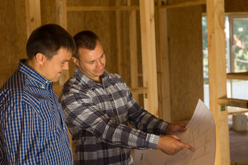 Architect and Client Discussing the Design