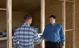 Professional Engineers Showing Handshake at Site poster