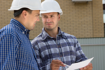 Engineer and Foreman at the Construction Site