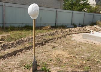 Construction Shovel with White Engineer Helmet