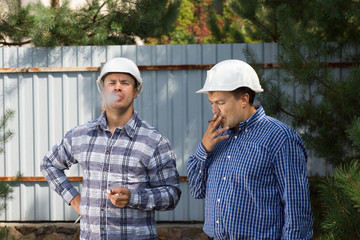 Two engineers taking a smoke break