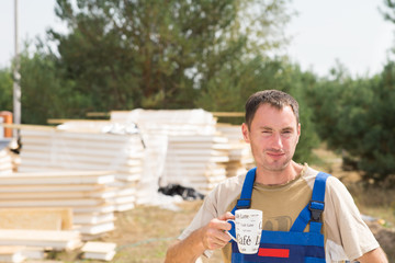 Workman taking a coffee break