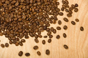 coffee seeds on wooden background