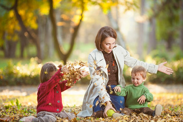 Playful family enjoying autumn day in a park