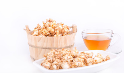 caramel popcorn on white background