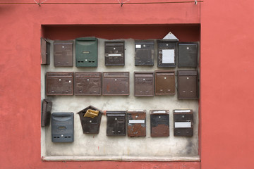 Collection of wall-mounted mail boxes