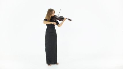 Beautiful girl in a long black dress playing the violin