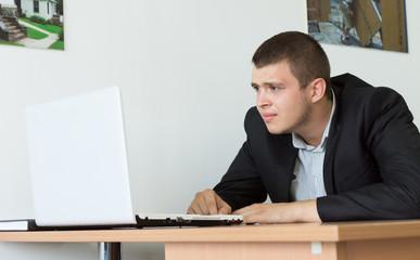 Serious Businessman Browsing Using Laptop