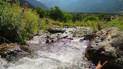 Mountain torrent running rapidly between the rocks, nature
