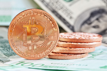 bitcoins with traditional dollars and euro as a background