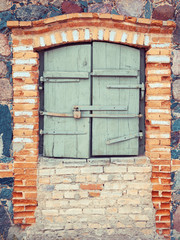 closed rustic window of old  house