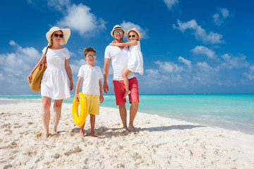 Family on a tropical beach vacation