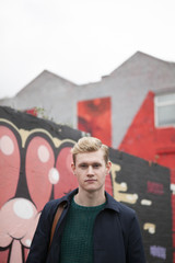 Portrait of blond guy in urban scene