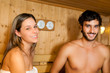 Beautiful couple relaxing while taking a sauna