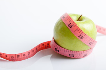 Measuring tape with green apple