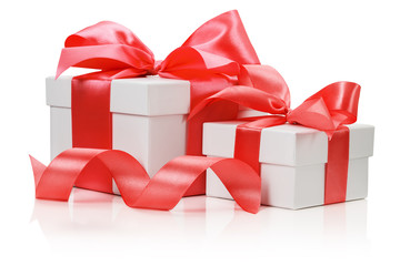 Two white boxes tied red ribbon bow isolated on the white backgr