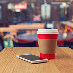 Paper coffee cup and smart phone