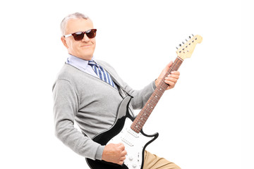 Cool senior playing a guitar