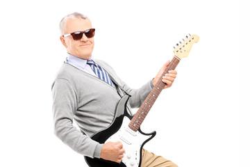 Cool senior playing a guitar