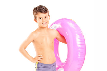 Cute little boy holding a swim ring