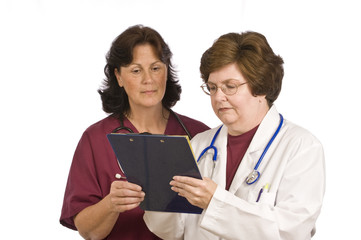 Doctor Giving Instructions To Nurse