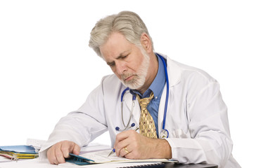 Doctor Completing Paperwork