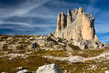 Two men running in Dolomites