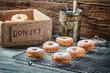 Falling icing sugar on fresh donuts
