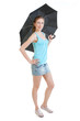Full-length portrait of young woman stands with black umbrella