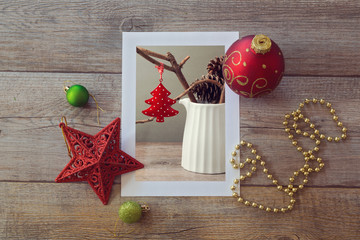 Christmas decoration photo on wooden table with ornaments