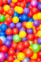 Bright background of colored plastic balls