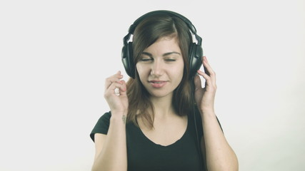 Attractive young woman puts on headphones
