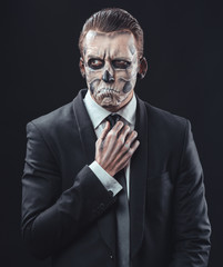 pensive businessman with makeup skeleton