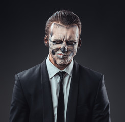 incredulous businessman with makeup skeleton