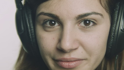 Attractive young woman listening to music on headphones